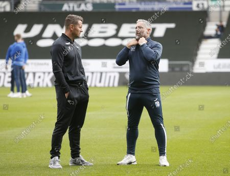 Barrow manager David Dunn chats to Derby County coach Shay Given