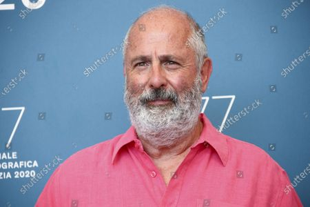 Roger Michell poses for photographers at the photo call for the film 'The Duke' during the 77th edition of the Venice Film Festival in Venice, Italy