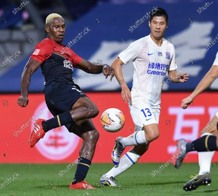 Stock Picture of John Mary (L) of Shenzhen Jiazhaoye passes the ball during the 9th round match between Shenzhen Jiazhaoye and Shanghai Greenland Shenhua at the postponed 2020 season Chinese Football Association Super League (CSL) Dalian Division in Dalian, northeast China's Liaoning Province, Sept. 4, 2020.
