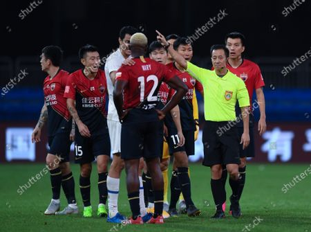 Stock Image of John Mary (C) of Shenzhen Jiazhaoye is sent off the game during the 9th round match between Shenzhen Jiazhaoye and Shanghai Greenland Shenhua at the postponed 2020 season Chinese Football Association Super League (CSL) Dalian Division in Dalian, northeast China's Liaoning Province, Sept. 4, 2020.
