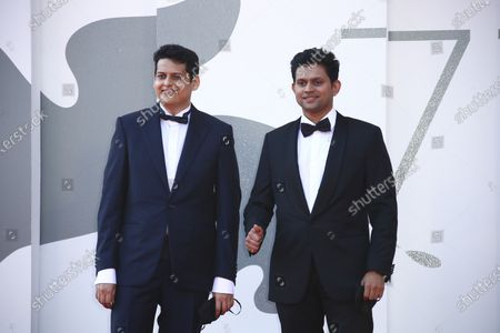 Director Chaitanya Tamhane, left, and actor Aditya Modak pose for photographers upon arrival at the premiere of the film 'The Disciple' during the 77th edition of the Venice Film Festival in Venice, Italy