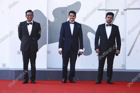 Actor Aditya Modak, from right, director Chaitanya Tamhane and producer Vivek Gomber pose for photographers upon arrival at the premiere of the film 'The Disciple' during the 77th edition of the Venice Film Festival in Venice, Italy