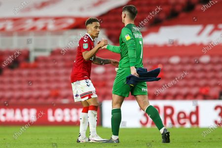 Middlesbrough midfielder Marcus Tavernier (7) shakes hands with Shrewsbury Town goalkeeper Harry Burgoyne (1) at the final whistle during the EFL Cup match between Middlesbrough and Shrewsbury Town at the Riverside Stadium, Middlesbrough