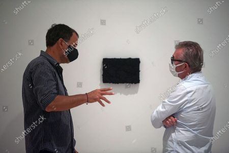 Bosco Sodi chatting with a visitor during the exhibition 'Ergo Sum' at Contemporary Art Centre. Mexican artist, Bosco Sodi arrives with around 40 works such as black monochromatic paintings in different formats and gold sculptures. The artist is known for his use of raw, natural materials to create large-scale textured paintings and objects. The exhibition will run in Malaga from 04 September to 06 December 2020.