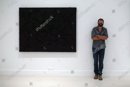 Mexican artist, Bosco Sodi poses for the media during the exhibition 'Ergo Sum' at Contemporary Art Centre. Mexican artist, Bosco Sodi arrives with around 40 works such as black monochromatic paintings in different formats and gold sculptures. The artist is known for his use of raw, natural materials to create large-scale textured paintings and objects. The exhibition will run in Malaga from 04 September to 06 December 2020.