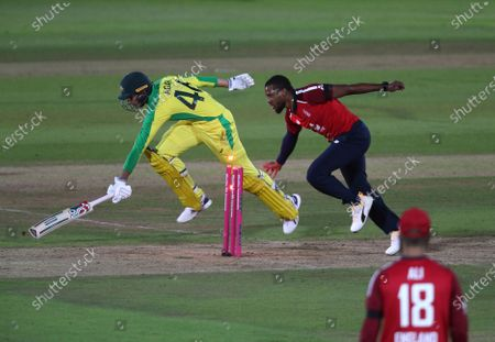England's Chris Jordan, right, runs out Australia's Ashton Agar, left, during the first Twenty20 cricket match between England and Australia, at the Ageas Bowl in Southampton, England