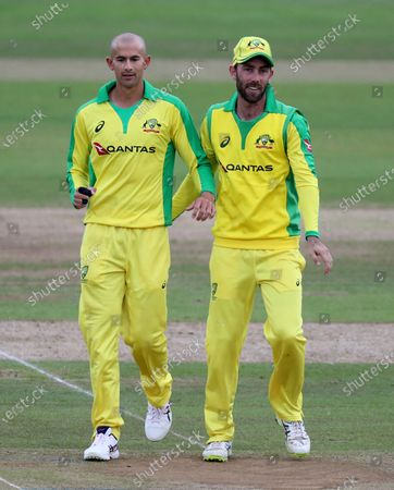 Australia's Ashton Agar, left, celebrates with teammate Glenn Maxwell the dismissal of England's Jos Buttler during the first Twenty20 cricket match between England and Australia, at the Ageas Bowl in Southampton, England