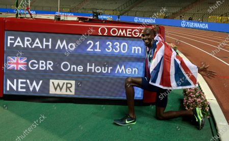 Great Britain's Mo Farah poses next to the board after setting a world record during the One Hour Men at the Diamond League Memorial Van Damme athletics event at the King Baudouin stadium in Brussels on