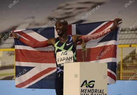 Great Britain's Mo Farah jubilates after setting a world record during the One Hour Men at the Diamond League Memorial Van Damme athletics event at the King Baudouin stadium in Brussels on