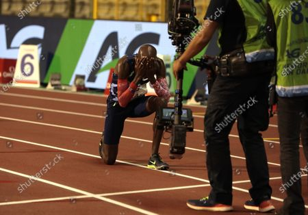 Great Britain's Mo Farah reacts after setting a world record during the One Hour Men at the Diamond League Memorial Van Damme athletics event at the King Baudouin stadium in Brussels on
