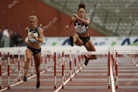 Great Britain's Katarina Johnson-Thompson, right, competes during the 100m Hurdles Women at the Diamond League Memorial Van Damme athletics event at the King Baudouin stadium in Brussels