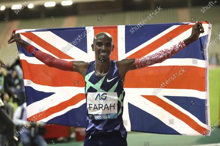 Great Britain's Mo Farah celebrates after winning the One Hour Men at the Diamond League Memorial Van Damme athletics event at the King Baudouin stadium in Brussels on . Farah set a new world record