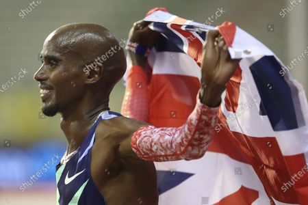 Great Britain's Mo Farah celebrates after winning the One Hour Men's race, at the Diamond League Memorial Van Damme athletics event at the King Baudouin stadium in Brussels on . Farah set a new world record
