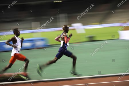 Great Britain's Mo Farah, right, competes to win the One Hour Men's race at the Diamond League Memorial Van Damme athletics event at the King Baudouin stadium in Brussels on . Farah set a new world record