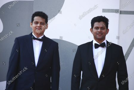 Director Chaitanya Tamhane, left, and Aditya Modak pose for photographers at the photo call for t poses for photographers upon arrival at the premiere of the film 'The Disciple' during the 77th edition of the Venice Film Festival in Venice, Italy