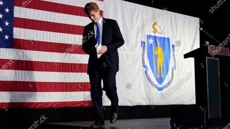 Rep. Joe Kennedy III walks off the stage after a gathering, in Watertown, Mass