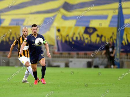 Al-Ittihad's player Karim El Ahmadi (back) in action against Al-Nassr's Giuliano (front) during the Saudi Professional League soccer match between Al-Ittihad and Al-Nassr, 30 kilometers north of Jeddah, Saudi Arabia, 04 September 2020.