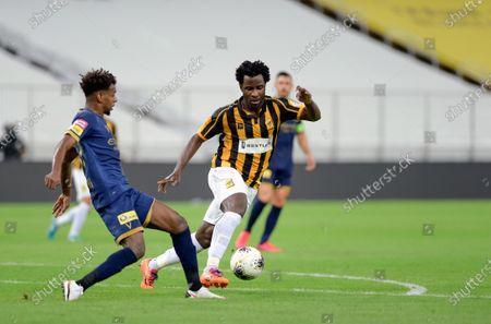 Al-Ittihad's player Wilfried Bony (R) in action against Al-Nassr's Abdullah Alkhaibari (L) during the Saudi Professional League soccer match between Al-Ittihad and Al-Nassr, 30 kilometers north of Jeddah, Saudi Arabia, 04 September 2020.