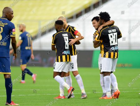 Stock Picture of Al-Ittihad's player Wilfried Bony (R) celebrates with teammates after scoring a goal during the Saudi Professional League soccer match between Al-Ittihad and Al-Nassr, 30 kilometers north of Jeddah, Saudi Arabia, 04 September 2020.