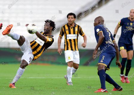 Al-Ittihad's player Wilfried Bony (L) in action against Al-Nassr's Abdullah Madu (R) during the Saudi Professional League soccer match between Al-Ittihad and Al-Nassr, 30 kilometers north of Jeddah, Saudi Arabia, 04 September 2020.