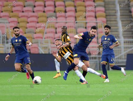 Al-Ittihad's player Anice Badri (C-L) in action against Al-Nassr's Petros (C-R) during the Saudi Professional League soccer match between Al-Ittihad and Al-Nassr, 30 kilometers north of Jeddah, Saudi Arabia, 04 September 2020.