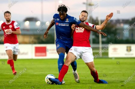 Stock Image of Waterford vs St. Patrick's Athletic. Waterford's Tunmise Sobowale with Robbie Benson of St Pats