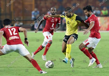 Stock Photo of Al-Ahly  players Handy Fathi (R) and Ayman Ashraf (L)  in action against Wadi Degla SC  player Ahmed Hassan (2R) during the Egyptian Premier League soccer match between Al-Ahly  and Wadi Degla SC at Cairo Stadium in Cairo, Egypt, 04 September  2020.