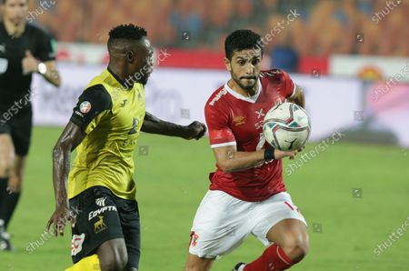 Stock Image of Al-Ahly  player  Ayman Ashraf  (R)  in action against Wadi Degla SC  player   Issahaku Yakubu (L) during the Egyptian Premier League soccer match between Al-Ahly  and Wadi Degla SC at Cairo Stadium in Cairo, Egypt, 04 September  2020.