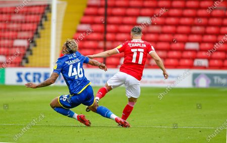 Stock Image of Conor Chaplin (11) of Barnsley FC and Nottingham Forests Jordan Gabriel (46) collide  during the EFL Cup match between Barnsley and Nottingham Forest at Oakwell, Barnsley