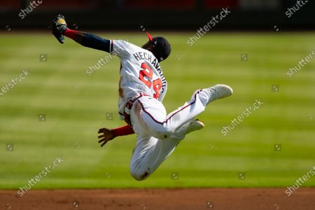 Stock Photo of Atlanta Braves' Adeiny Hechavarria makes a leaping catch of a line drive by Washington Nationals' Howie Kendrick during the first inning of a doubleheader baseball game, in Atlanta