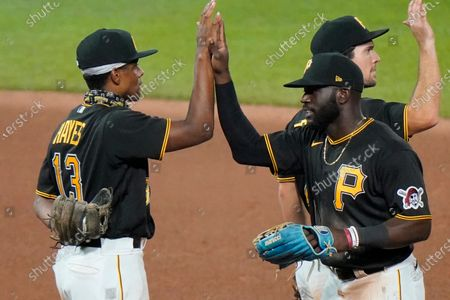 Stock Picture of Pittsburgh Pirates' Ke'Bryan Hayes, left, and Anthony Alford, right front, celebrate a win in the second baseball game of a doubleheader against the Cincinnati Reds in Pittsburgh