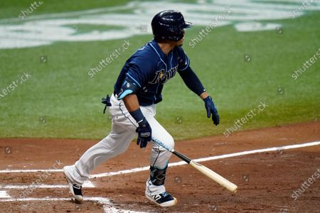 Tampa Bay Rays' Michael Perez follows the flight of his three-run double off Miami Marlins starting pitcher Pablo Lopez during the fourth inning of a baseball game, in St. Petersburg, Fla