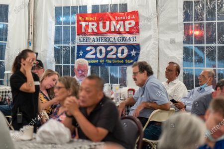Stock Picture of A banner for Trump/Pence US election ticket seen during a Steve Bannon Speaking Engagement on Zoom with Queens Village Republican Club in Triple Crown Diner, Middle Village, Queens.