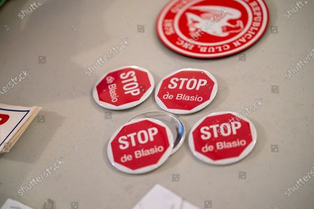 """Buttons that reads, """"Stop De Blasio"""" seen during a Steve Bannon Speaking Engagement on Zoom with Queens Village Republican Club in Triple Crown Diner, Middle Village, Queens."""