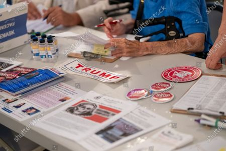 Stock Image of Press materials seen during a Steve Bannon Speaking Engagement on Zoom with Queens Village Republican Club in Triple Crown Diner, Middle Village, Queens.