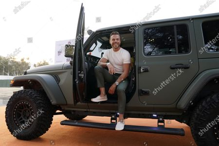 Stock Photo of Professional dancer Derek Hough poses from his car as he arrives at the Drive-In to Erase MS gala, in Pasadena, Calif