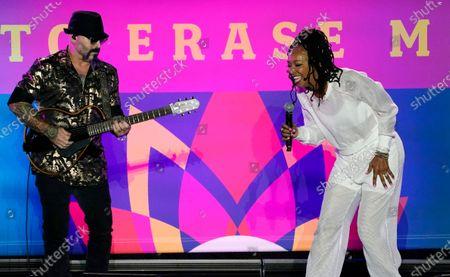 Singer Siedah Garrett, right, performs at the Drive-In to Erase MS gala, in Pasadena, Calif