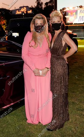 Nancy Davis, left, founder of the Race to Erase MS, poses with actress Anne Heche at the Drive-In to Erase MS gala, in Pasadena, Calif