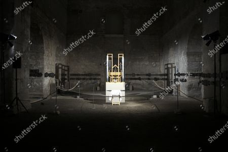 Stock Photo of The organ of the John Cage organ project is illuminated prior to a 'sound change' at the partially ruined Buchardi Church in Halberstadt, Germany, . Since 2001 an interpretation of the music peace 'Organ/ASLSP', As Slow As Possible, by US composer John Cage is performed on the organ. The total duration of the piece is planned for 639 years without any stop