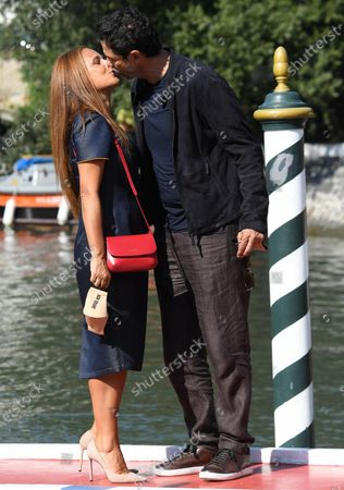 Alessandro Gassmann (R) and his wife Sabrina Knaflitz arrive at Lido Beach for the 77th annual Venice International Film Festival, in Venice, Italy, 05 September 2020, where he will present the movie 'Non Odiare.' The event is the first major in-person film fest to be held in the wake of the Covid-19 coronavirus pandemic. Attendees have to follow strict safety measures like mandatory face masks indoors, temperature scanners, and socially distanced screenings to reduce the risk of infection. The public is barred from the red carpet, and big stars are expected to be largely absent this year. The 77th edition of the festival runs from 02 to 12 September 2020.