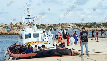 Stock Picture of Migrants sit in a boat to be transferred to the quarantine ship Rhapsody, in Lampedusa, Italy, 05 September 2020. More than 800 migrants, of which about 20 are tested positive to the Covid-19, are to be transferred to the quarantine ship.