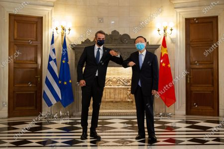 Greek Prime Minister Kyriakos Mitsotakis (L) meets with Yang Jiechi, a member of the Political Bureau of the Communist Party of China (CPC) Central Committee and director of the Office of the Foreign Affairs Commission of the CPC Central Committee, in Athens, Greece, on Sept. 4, 2020.