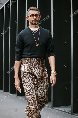 Simone Marchetti wearing glasses, black sweatshirt, tiger print pants, seen outside Gucci show during Milan Fashion Week Womenswear Spring Summer 2020