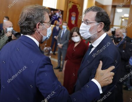 Galicia regional president Alberto Nunez Feijoo (L) greets former Prime Minister Mariano Rajoy (R) after taking an oath for fourth time during an act held in Santiago de Compostela, Galicia, Spain, 05 September 2020.