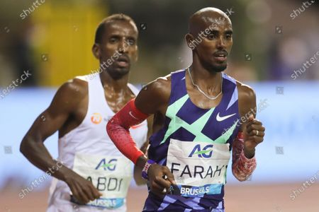 Britain's Mo Farah (R) runs during the One Hour Men at the Diamond League Memorial Van Damme athletics event at the King Baudouin stadium in Brussels, Belgium, Sept. 4, 2020. Farah set a new world record.