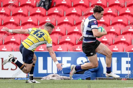 Dolphin vs Old Crescent. Old Crescent's Jack O'Neill runs in a try despite Cameron O'Shaughnessy of Dolphin