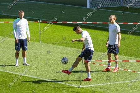 Stock Photo of Switzerland's Haris Seferovic, Granit Xhaka and Michael Lang, from left, during a training session the day before the UEFA Nations League group 4 soccer match between Switzerland and Germany at the St. Jakob-Park stadium in Basel, Switzerland, on Saturday, September 5, 2020.