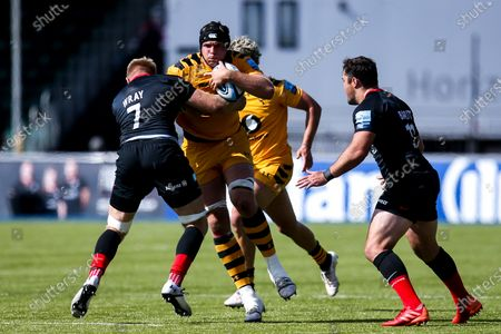 Tim Cardall of Wasps is tackled by Jackson Wray of Saracens