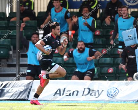Sean Maitland runs in the 2nd Saracens Try as the substitutes cheer