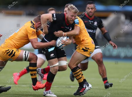 Jackson Wray of Saracens is tackled by Jimmy Gopperth of Wasps